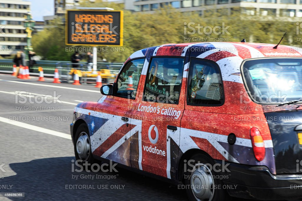 London Taxi Cab on Westminster Bridge, United Kingdom stock photo