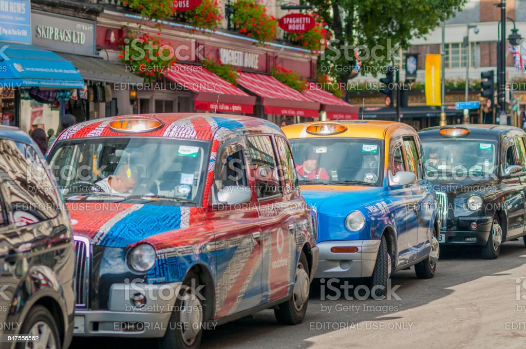 London taxi cabs waiting at traffic light near Leicester Square stock photo