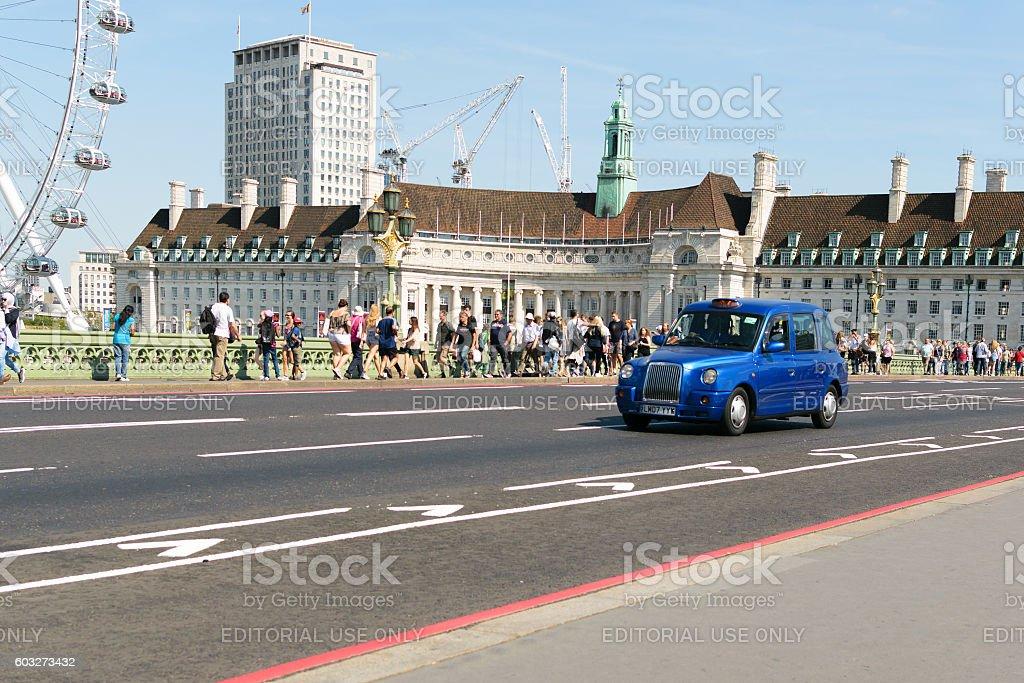 London taxi crosses Westminster Bridge stock photo