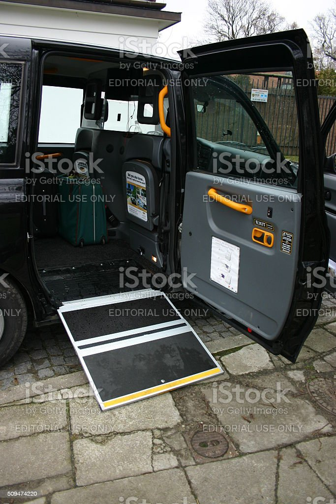London taxi with open door and wheelchair ramp stock photo