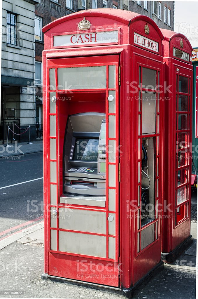 London Technology phone booth with bank machine stock photo