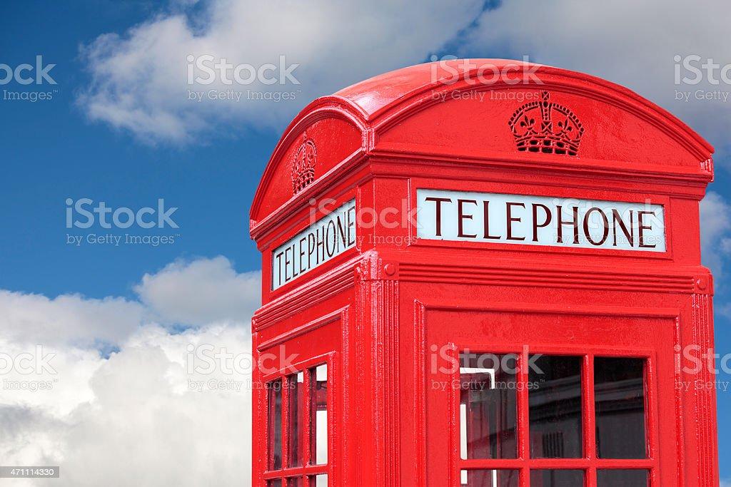 London telephone box cloudy blue sky stock photo