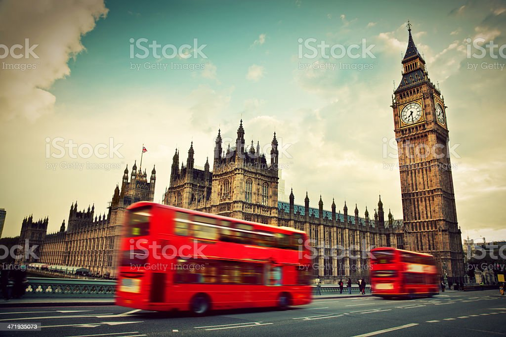 London, the UK. Red bus in motion and Big Ben stock photo