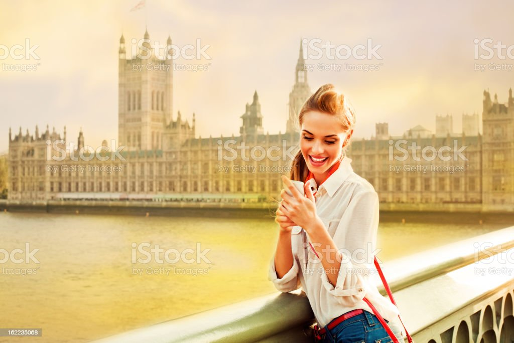 London Tourist with Smart Phone royalty-free stock photo