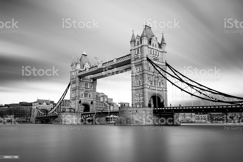 London Tower Bridge across Thames in black and white stock photo