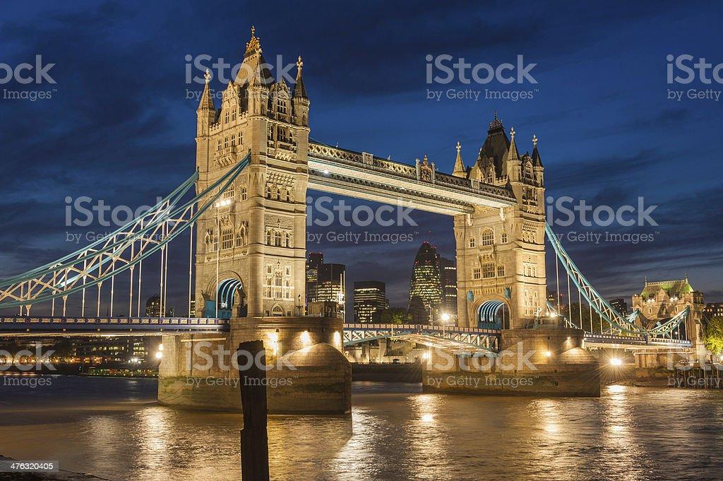London Tower Bridge illuminated at dusk over River Thames UK stock photo