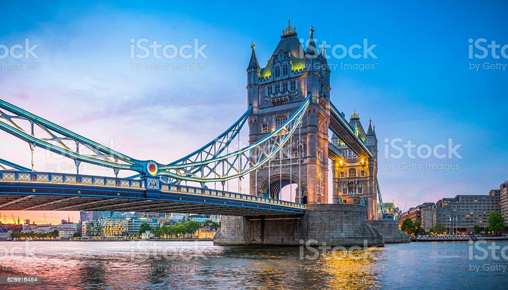 London Tower Bridge illuminated at sunset over River Thames panorama stock photo