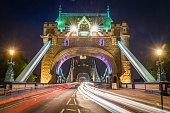 London Tower Bridge traffic zooming through bright city lights UK