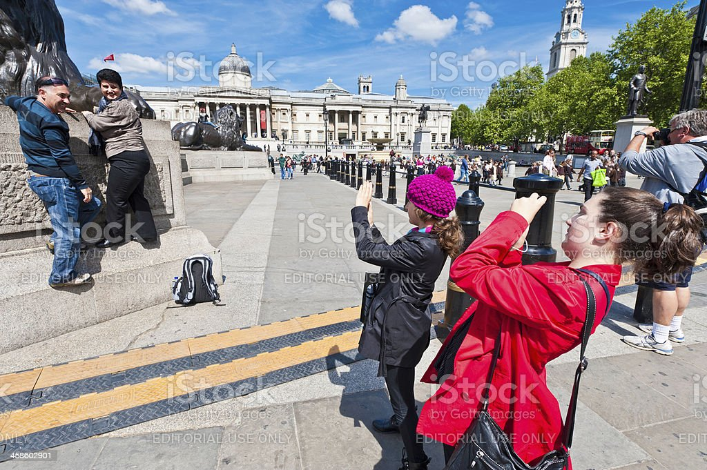 London Trafalgar Square tourists photographing lions royalty-free stock photo