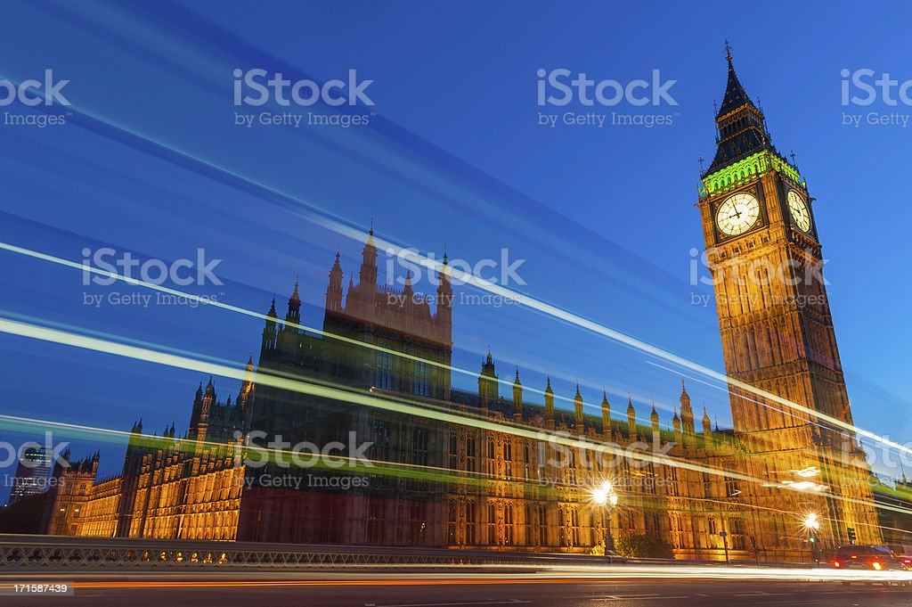 London traffic zooming past Big Ben Westminster Parliament stock photo