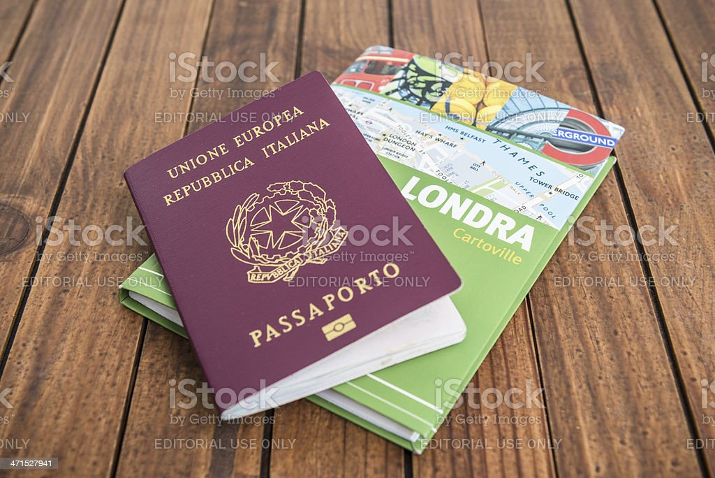 Close up of group of London travel guide books on the wood table with...