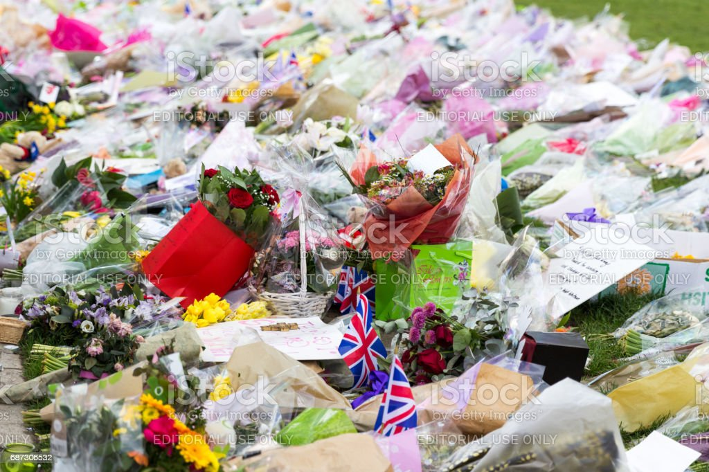 London, UK - 1st April, 2017: Parliament Square has been covered with flowers for those killed in terrorist attack, London, Uk. stock photo
