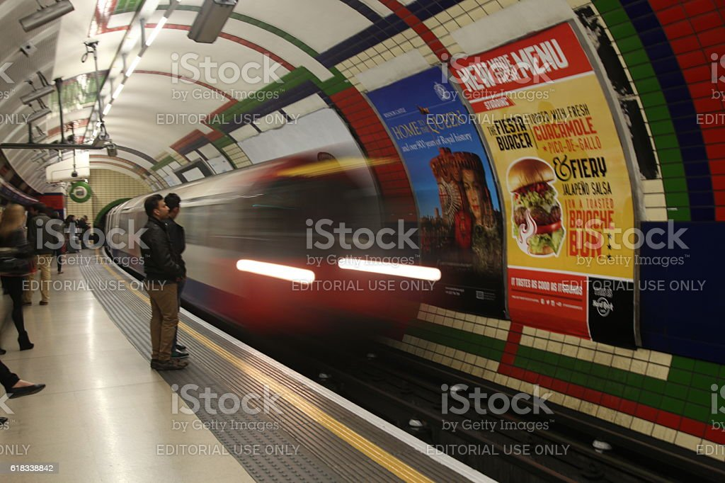 London underground train approaching station stock photo