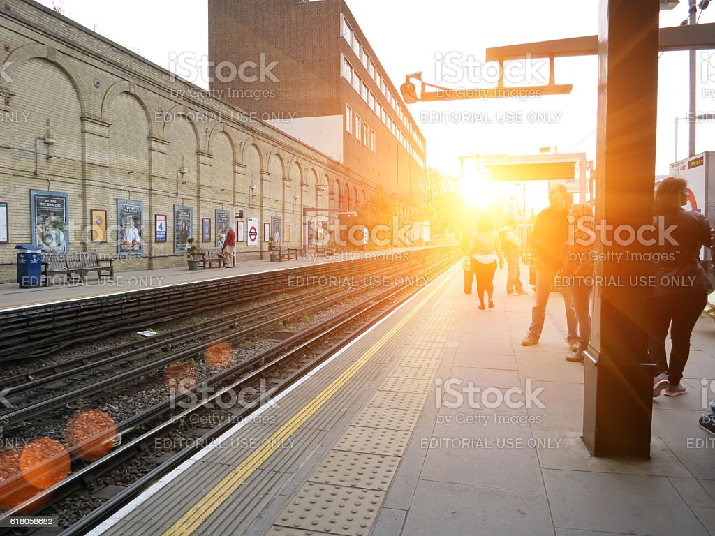 London underground West Brompton station. Commuters are waiting for...