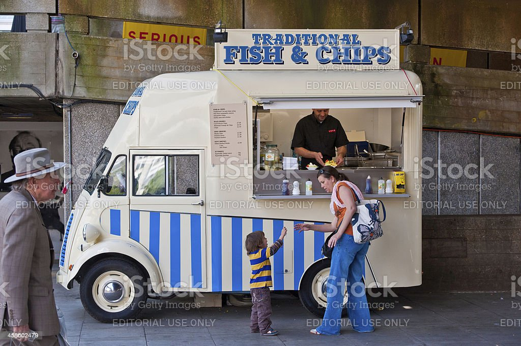 London woman buying fish and chips for child royalty-free stock photo