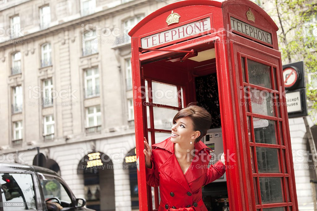 London Woman in Red Phone Booth royalty-free stock photo