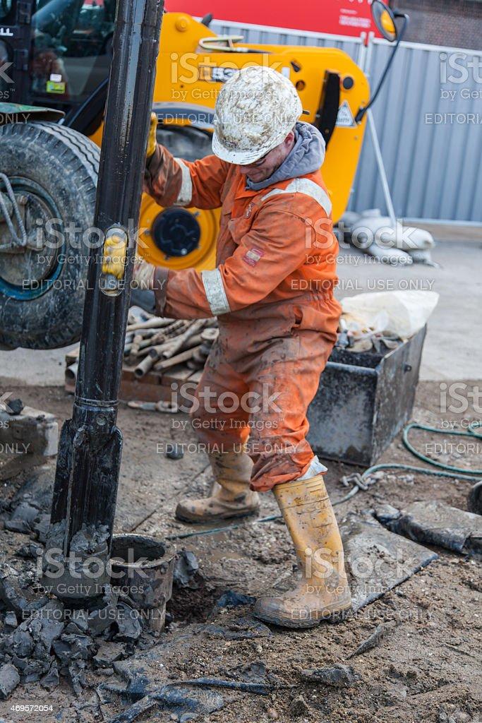 London Workman a drilling a borehole stock photo