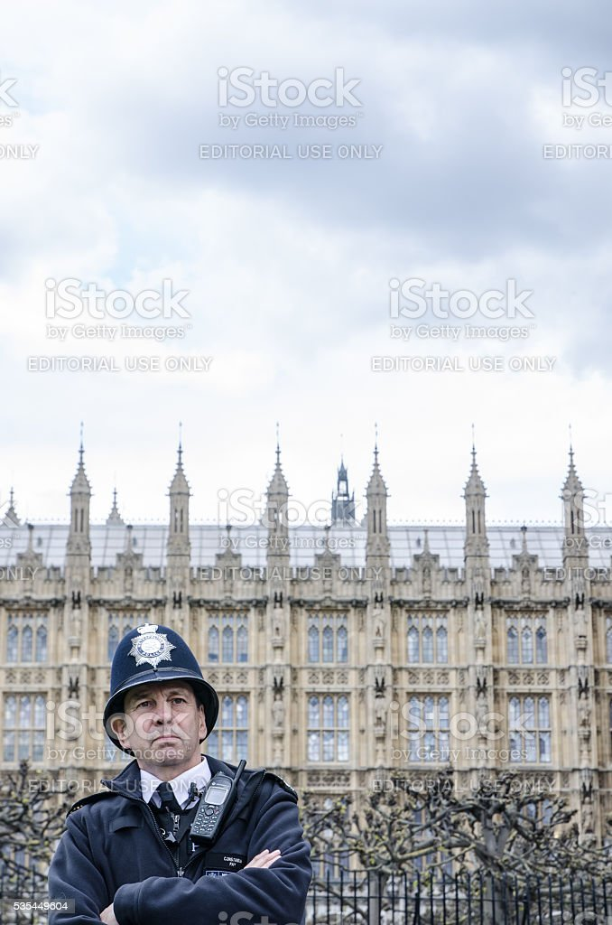 Londonian policeman at side entrance of the Westminster Palace stock photo