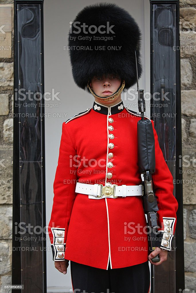 London's Queen Guard in Red Uniform Standing at His Post stock photo