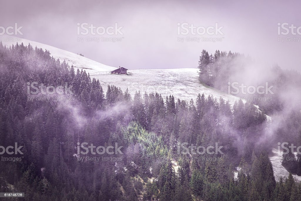 Lone Barn at the edge of a snow field stock photo