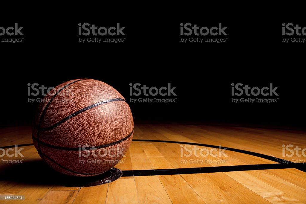 Lone basketball on the basketball court stock photo