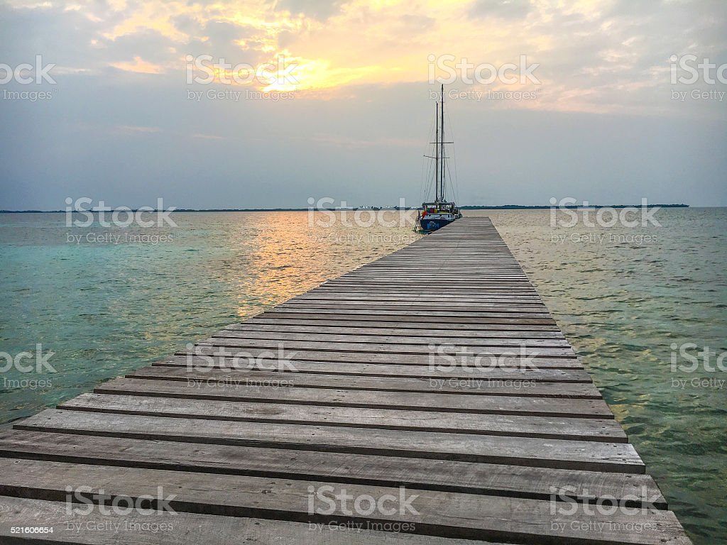 Lone boat and dock stock photo