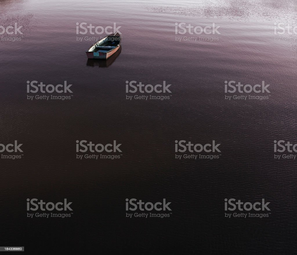 Lone Boat at Sunset royalty-free stock photo