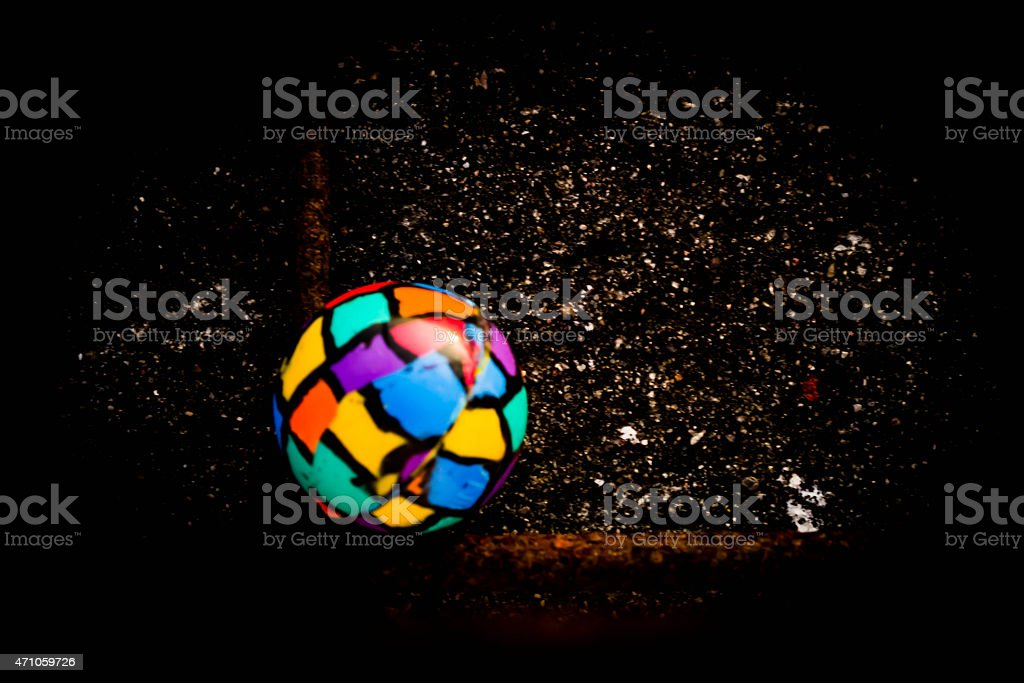 Lone bouncing ball stock photo