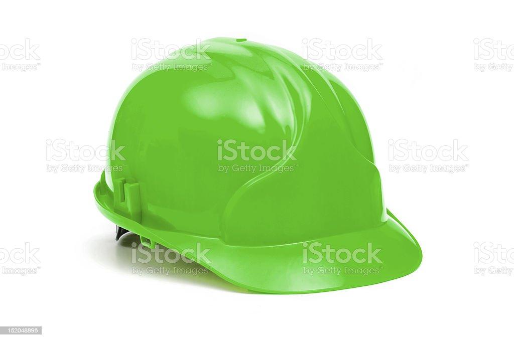 Lone bright green construction helmet on white background stock photo