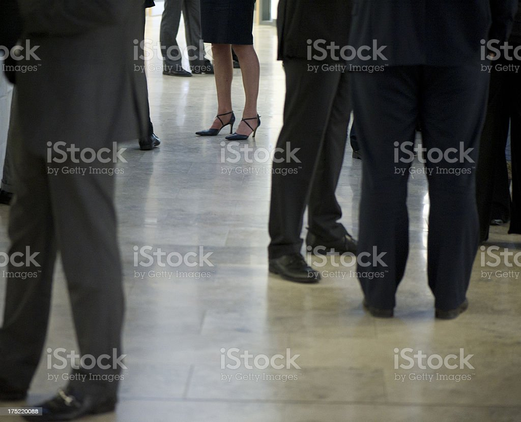 lone businesswoman in a male dominated business environment stock photo