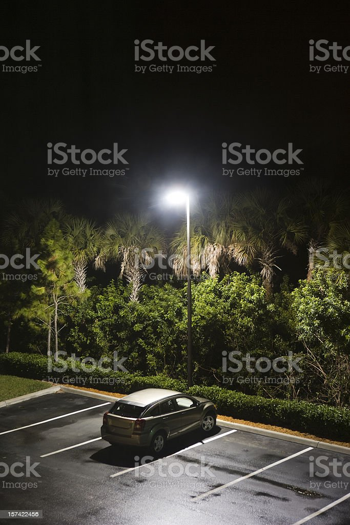 lone car in a parking lot royalty-free stock photo