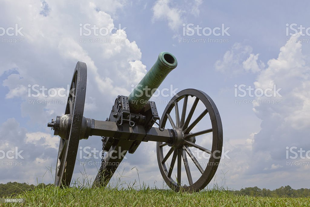 Lone Civil War Cannon With Storm Clouds Gathering Overhead royalty-free stock photo