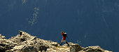 'Lone climber on rock outcrop, Nelson, New Zealand'