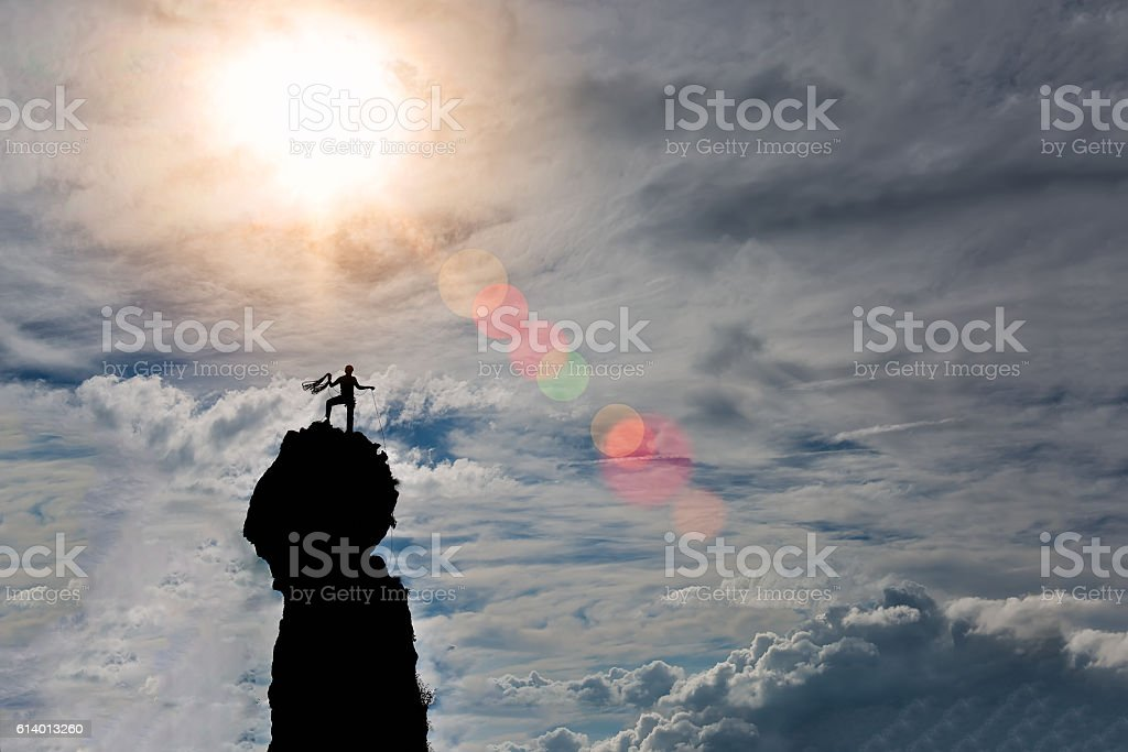 lone climber on the summit of the mountain stock photo