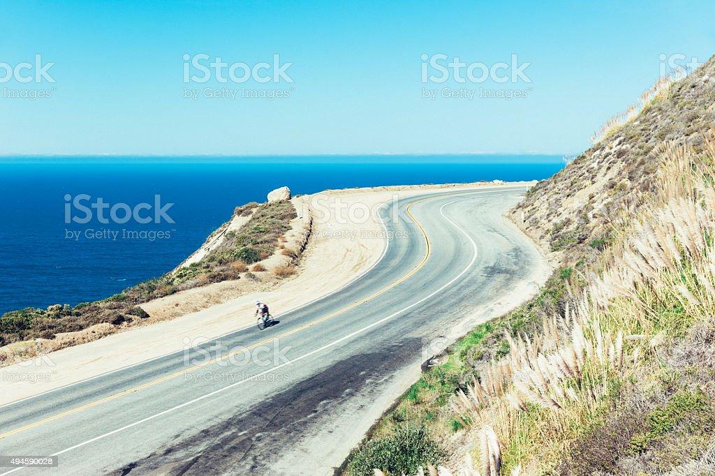 Lone cyclist on Highway 1, Big Sur, California stock photo
