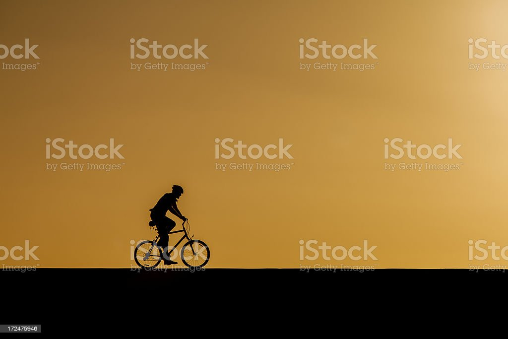 lone cyclist riding royalty-free stock photo