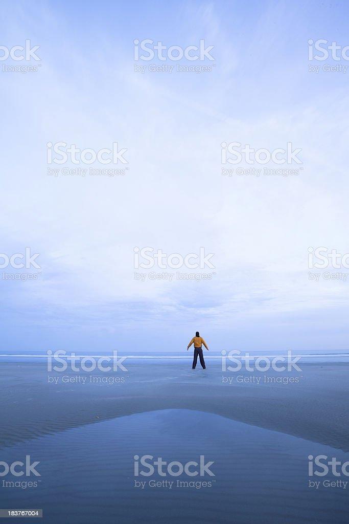 Lone figure on an empty beach royalty-free stock photo