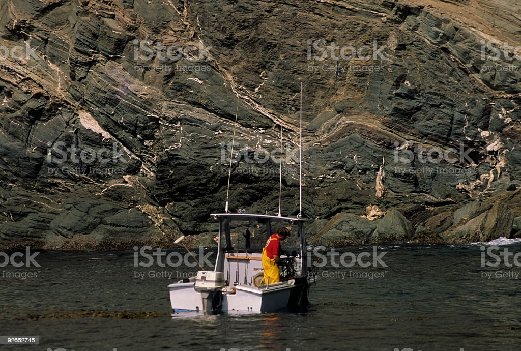 Lone Fisherman On Boat stock photo