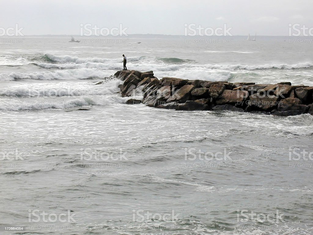 Lone Fisherman on the Jetty stock photo