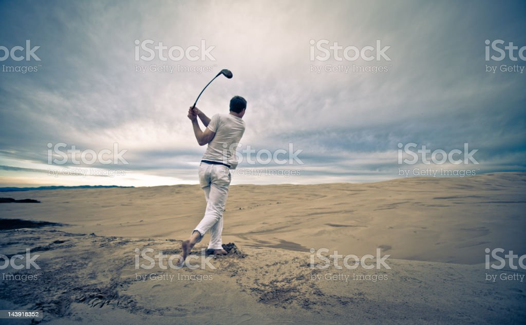 Lone golfer in an infinite sand trap royalty-free stock photo
