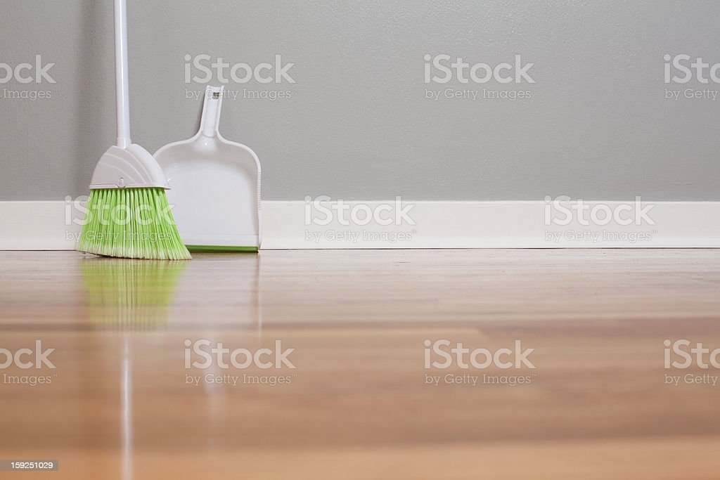 A lone green broom and dust pan stock photo