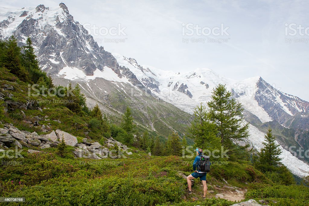 Lone hikers look up at the Mont Blanc stock photo