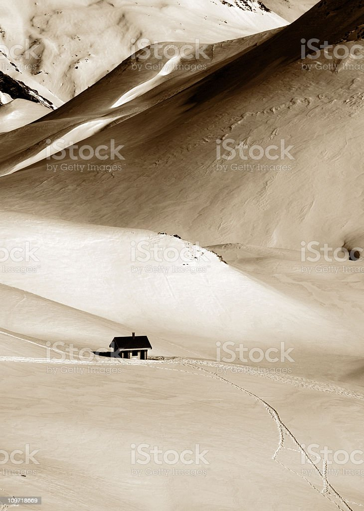 Lone House in Snow Covered Alps royalty-free stock photo