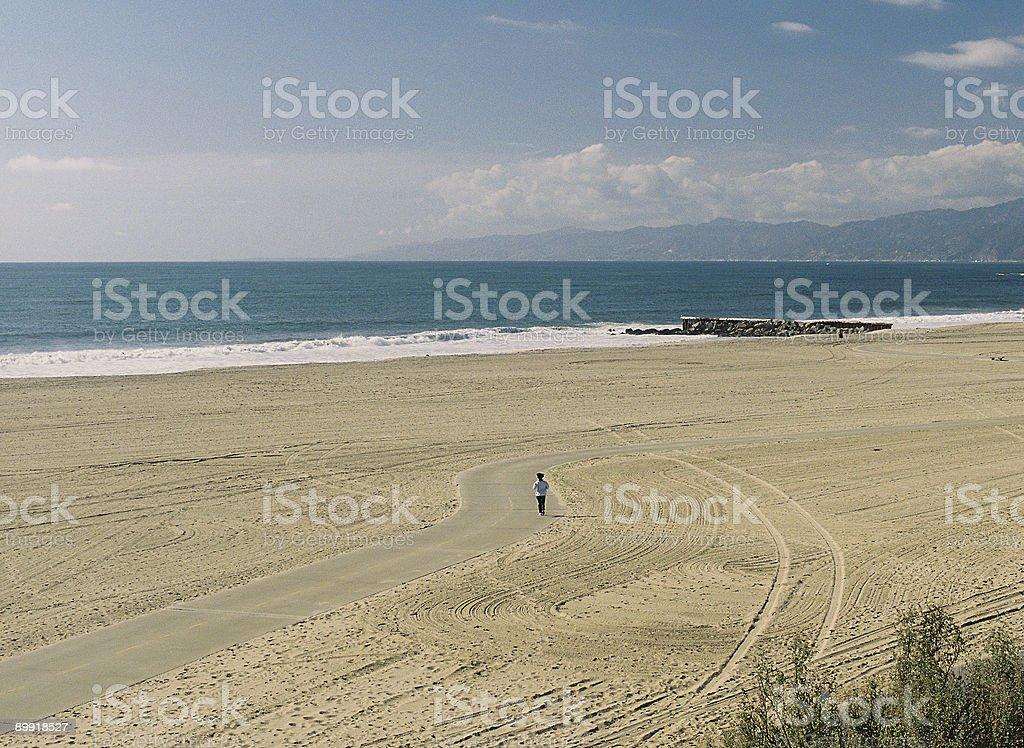 Lone jogger on California beach royalty-free stock photo