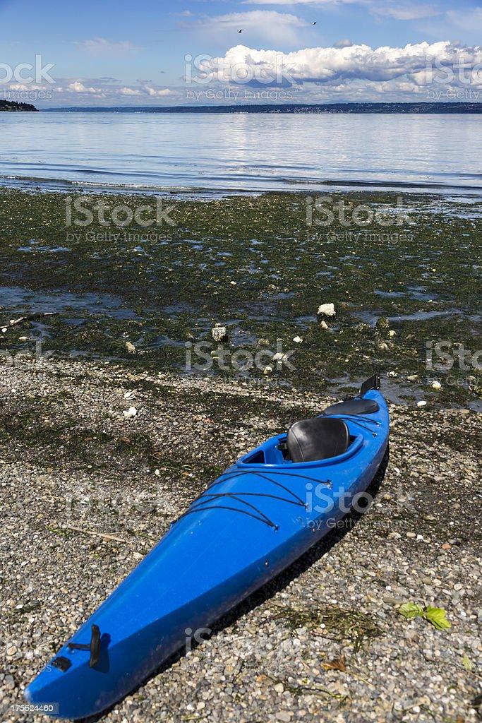 Lone Kayak on a stony beach royalty-free stock photo