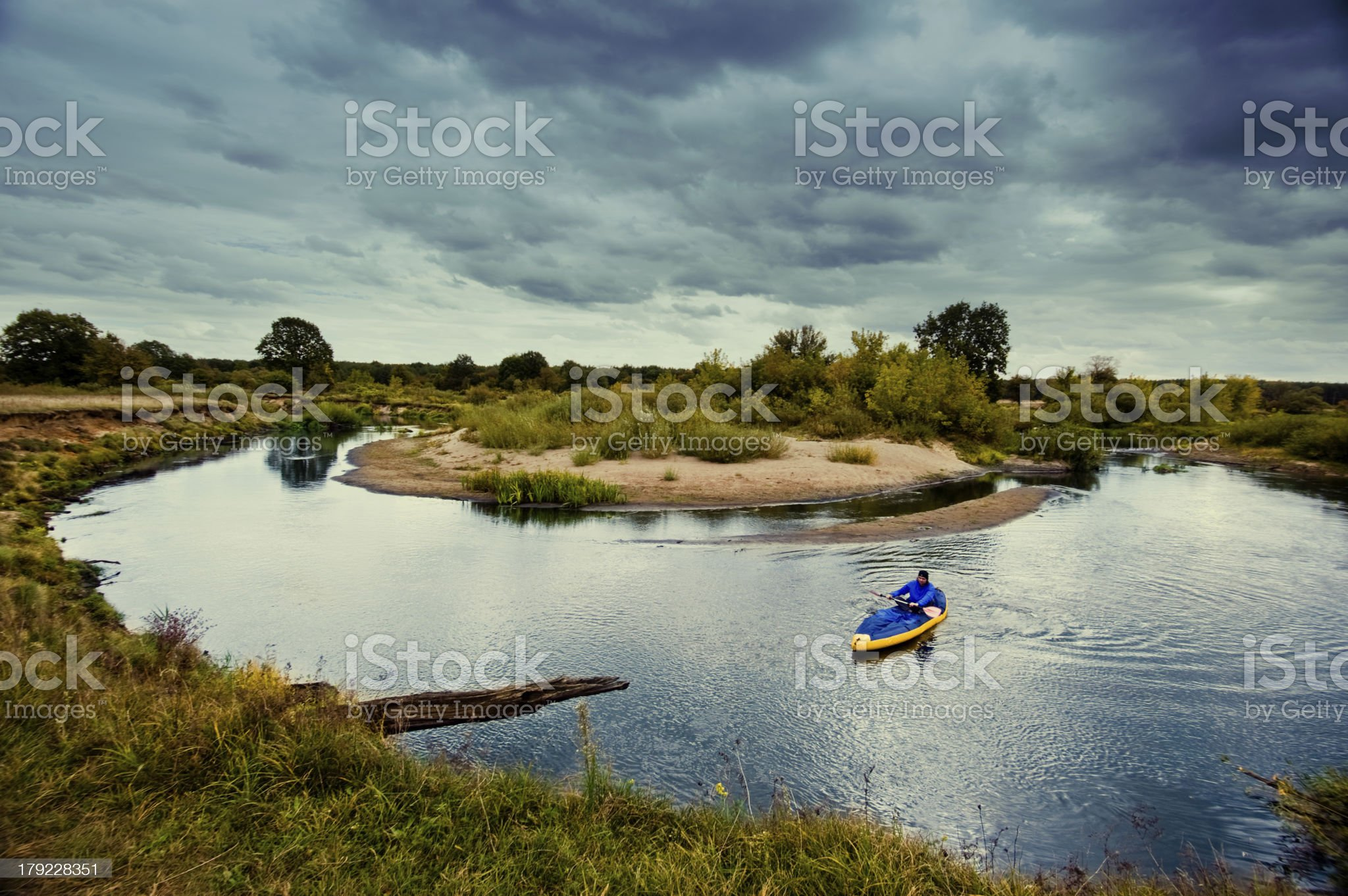 lone kayaker on river before the storm. royalty-free stock photo