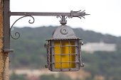 Lone lantern illuminates Costa Brava. The metal lamp