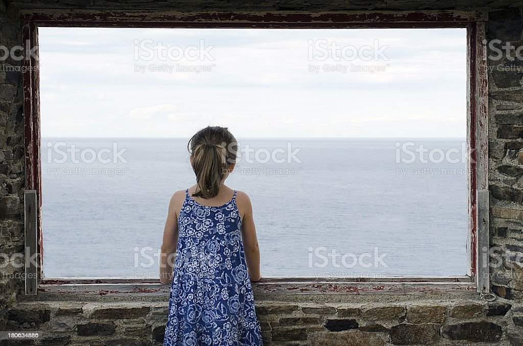 Lone little girl looking the sea royalty-free stock photo