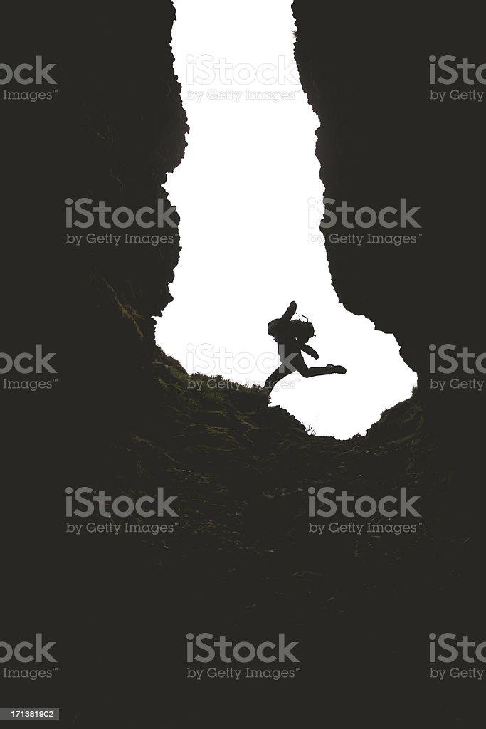 Lone Man Hiking Through Deep Natural Ravine stock photo