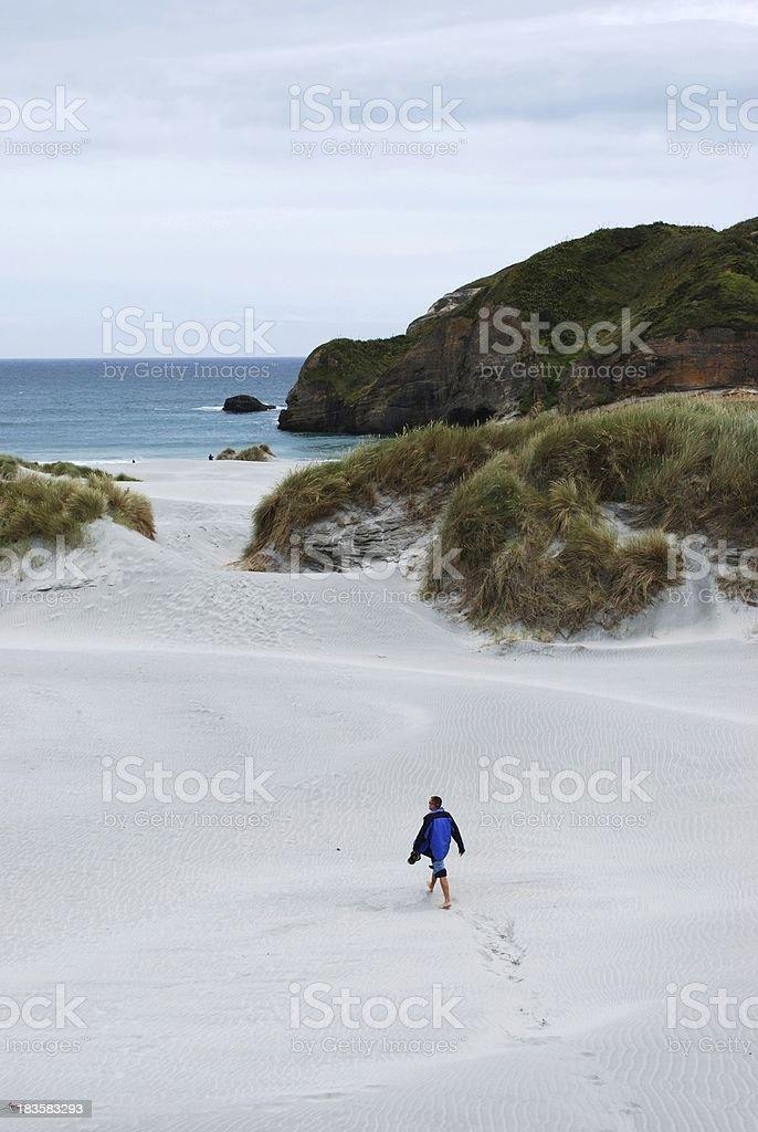 Lone Man on Beach stock photo